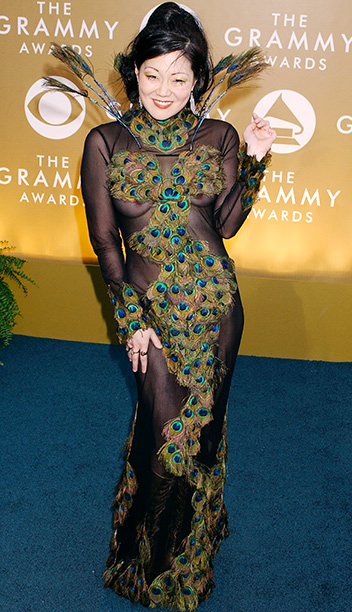 In 2004, a svelte Margaret Cho shook her tail feather in this Derek of Narcisse ''couture peacock feather fantasy.'' It was named worst dress of…
