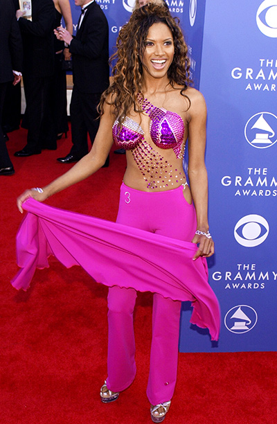 Oh, former Baywatch star Traci Bingham. Did we learn nothing from the Great Lil' Kim VMA Pastie Scandal of 1999? Bedazzling your nipples does not…