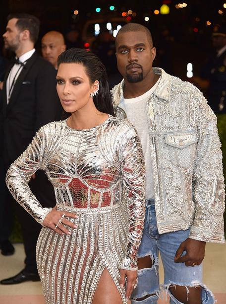 Kim Kardashian (in Balmain) and Kanye West