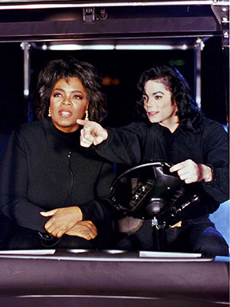 Oprah and Michael in a golf cart (February 1993)