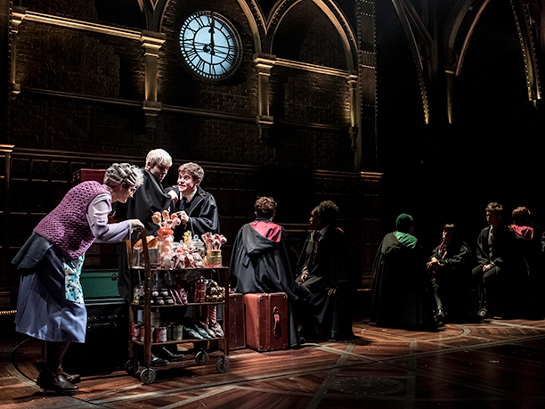 All aboard the Hogwarts Express: The Trolley Witch (Sandy McDade) serves up treats to Scorpius (Anthony Boyle) and Albus (Sam Clemmett)