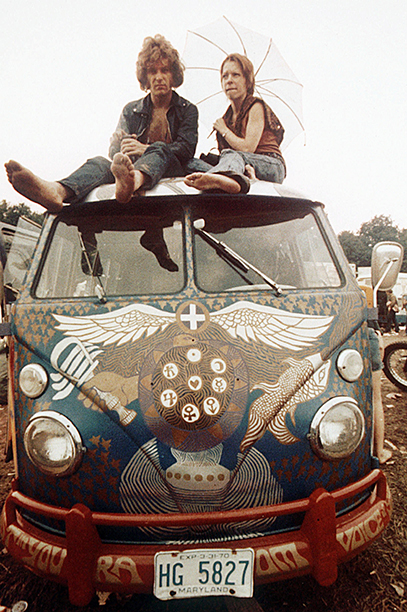 Woodstock Attendees On Top of a VW Bus
