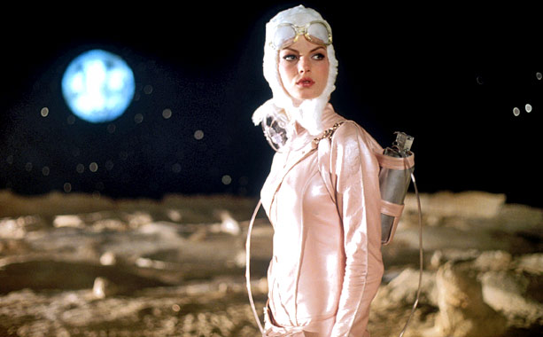 Angela Lindvall | Leading lady Angela Lindvall took a break from modeling to play Valentine/Dragonfly in this 2001 homage to Barbarella . With it?s white fur collar, the…