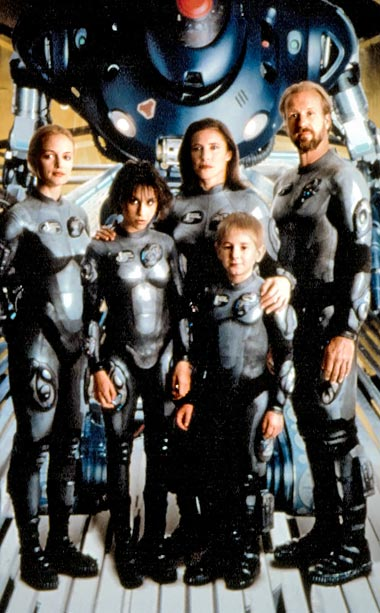 Lost in Space | For the 1998 adaptation of the 1965 CBS television series—which chronicles the Robinson family?s trip to outer space—costume designer Vin Burnham created sleek silver latex…