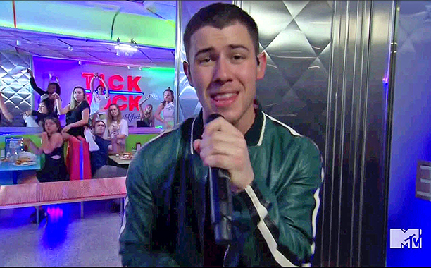 Nick Jonas Performs In a Diner