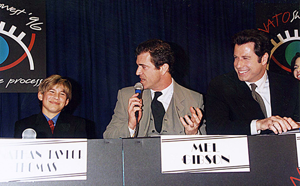 Jonathan Taylor Thomas With Mel Gibson and John Travolta at ShoWest '96 on September 7, 1996