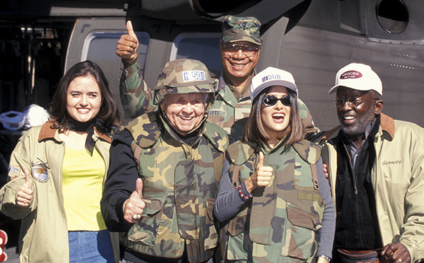 Salma Hayek With Danica McKellar, Johnny Grant, Maj. Gen. Peter Gravett, and Garrett Morris at USO's Operation Starlift on November 22, 1999