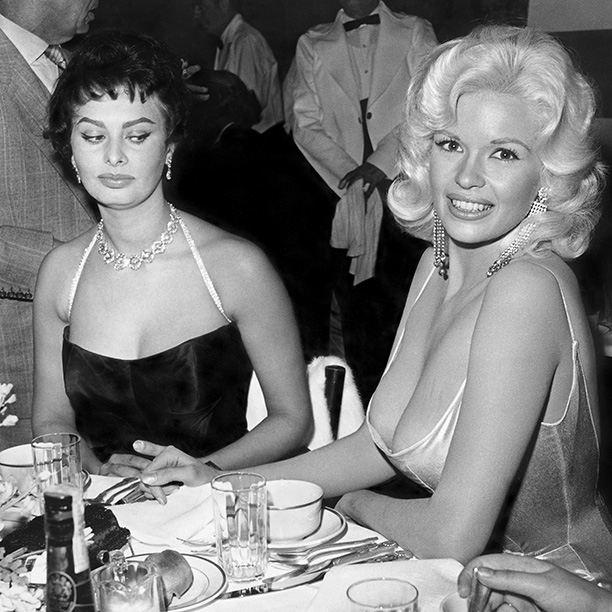 Sophia Loren | They didn't know each other at all, but Loren and bombshell actress Jayne Mansfield will always be cosmically bonded by this legendary photo. ''Listen,'' Loren…
