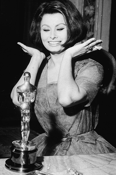 Sophia Loren | ''I look very happy next to my Oscar, no?'' says Loren. ''And with the cigarette in my hand, of course, even though I don't smoke.…