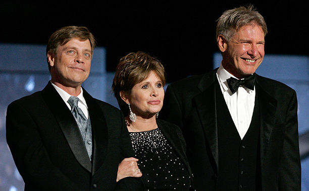 Carrie Fisher With Mark Hamill and Harrison Ford at the 33rd AFI Life Achievement Award Tribute to George Lucas in Hollywood on June 9, 2005