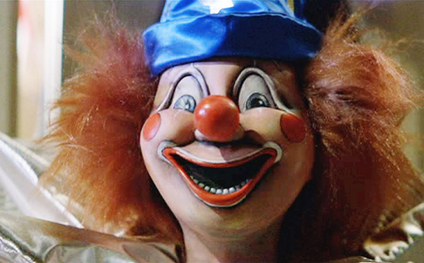 The clown doll lurking in the room of siblings Carol Anne and Robbie Freeling is basically the Chekhov's gun of Poltergeist —when viewers see his…