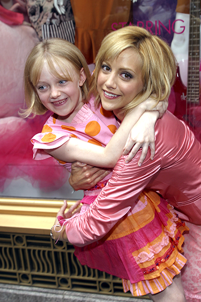 Brittany Murphy With Dakota Fanning at the Uptown Girls Window Display at Henri Bendel in New York City on August 7, 2003