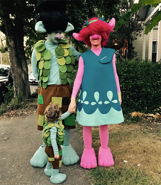 Justin Timberlake, Jessica Biel, and Silas as Trolls Poppy, Branch, and Lil Branch