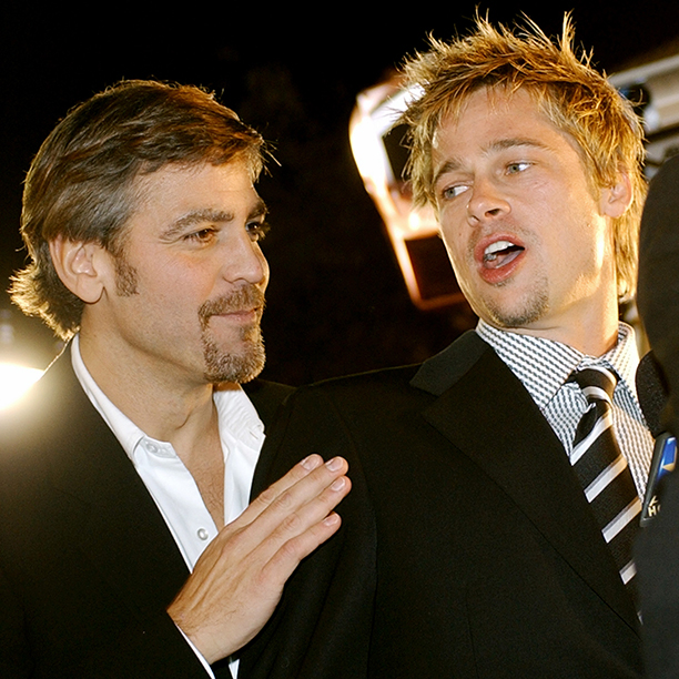 """GALLERY: 'Ocean's Eleven' Premiere: AP_01120503980.jpg """"Ocean's Eleven"""" cast members George Clooney, left, and Brad Pitt chat during the premiere of the film Wednesday, Dec. 5, 2001"""