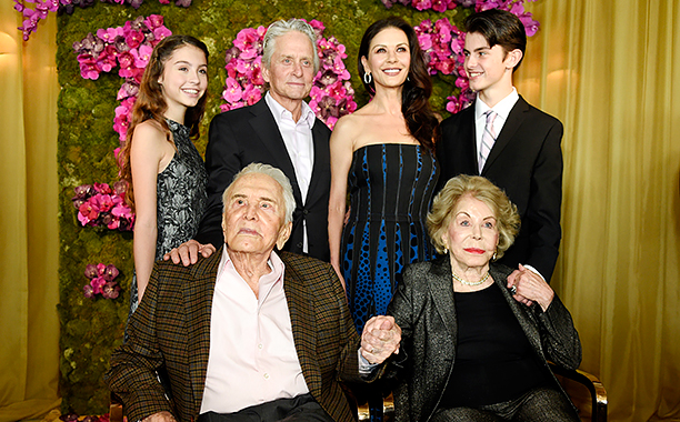 ALL CROPS: AP_16345161266418 Actor Kirk Douglas, seated left, holds hands with his wife Anne Douglas, seated right, as they pose with family members, their son Michael, standing second left standing, his wife Catherine Zeta-Jones