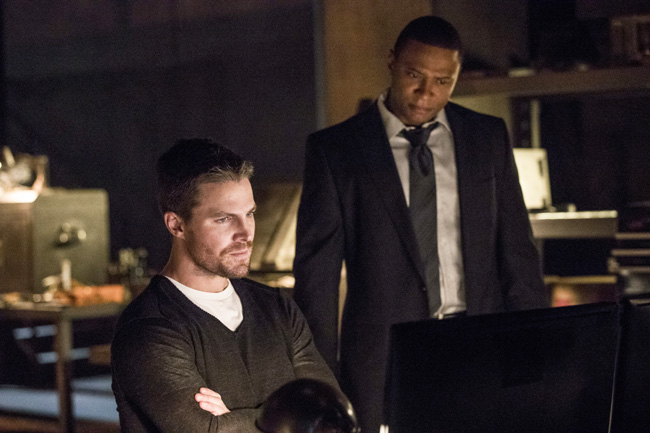"""All Crops: Arrow -- """"What We Leave Behind"""" -- Image AR509a_0443b.jpg -- Pictured (L-R): Stephen Amell as Oliver Queen and David Ramsey as John Diggle -- Photo: Jack Rowand/The CW -- © 2016 The CW Network, LLC. All Rights Reserved"""