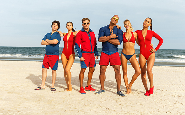 ALL CROPS: (L-R) Jon Bass plays Ronnie, Alex Daddario plays Summer, Zac Efron plays Matt Brody, Dwayne Johnson plays Mitch Buchannon, Kelly Rohrbach plays CJ Parker, and Ilfenesh Hadera plays Stephanie Holden in BAYWATCH; the film by Paramount Pictures