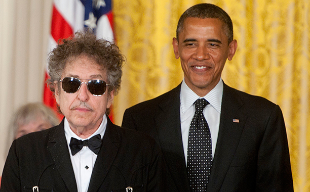 ALL CROPS: 145427705 Bob Dylan receives the Presidential Medal of Freedom from President Barack Obama in the East Room of the White House on May 29, 2012 in Washington, DC. (Photo by Leigh Vogel/WireImage)