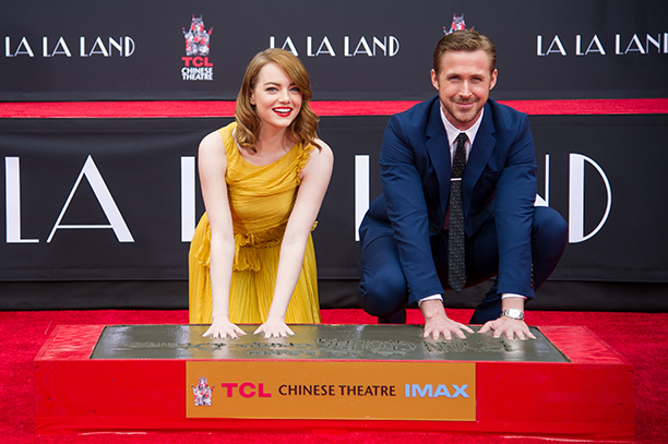 NO CROPS: 628354470 Actors Emma Stone (L) and Ryan Gosling attend 'Ryan Gosling and Emma Stone hand and footprint ceremony' at TCL Chinese Theatre IMAX on December 7, 2016 in Hollywood, California. (Photo by Emma McIntyre/Getty Images)