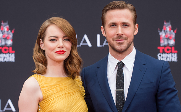 ALL CROPS: 628354286 Actors Emma Stone (L) and Ryan Gosling attend 'Ryan Gosling and Emma Stone hand and footprint ceremony' at TCL Chinese Theatre IMAX on December 7, 2016 in Hollywood, California. (Photo by Emma McIntyre/Getty Images)