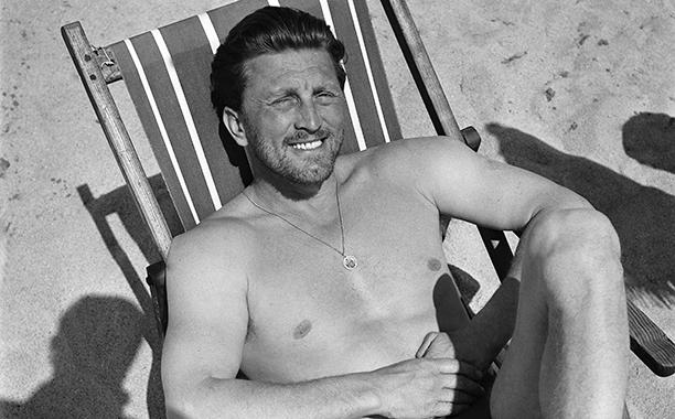 GALLERY: Kirk Douglas Through the Years: GettyImages-110135039.jpg Kirk Douglas on a beach in 1950's.