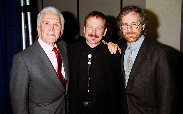 GALLERY: Kirk Douglas Through the Years: GettyImages-111176277.jpg September 7, 1994 Kirk Douglas, Robin Williams and Steven Spielberg during 1994 ShoWest in Las Vegas, Nevada, United States.
