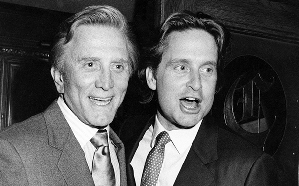 """GALLERY: Kirk Douglas Through the Years: GettyImages-112026397.jpg March 9, 1983 Kirk Douglas and Michael Douglas during """"Welcome to L.A."""" Party for Julio Iglesias at Chasen's Restaurant in Beverly Hills, California, United States."""