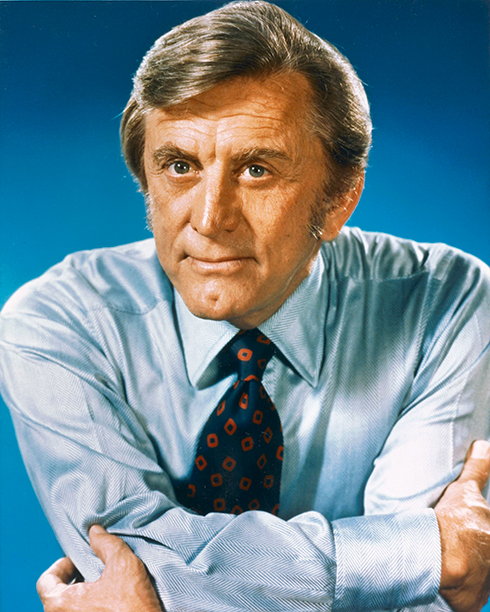 GALLERY: Kirk Douglas Through the Years: GettyImages-120355530.jpg Kirk Douglas, US actor, wearing a light blue shirt and a dark blue tie, with red motifs, circa 1970.