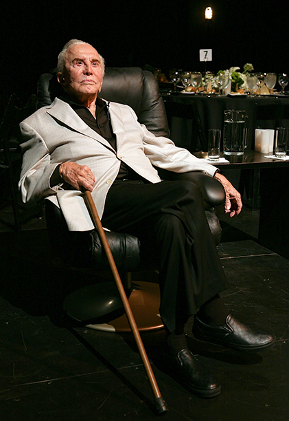 GALLERY: Kirk Douglas Through the Years: GettyImages-125004387.jpg Kirk Douglas poses during the Theatre Artist Dinner on the stage of the Kirk Douglas Theatre on September 14, 2011 in Los Angeles, California.