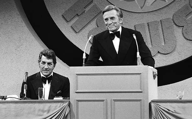 """GALLERY: Kirk Douglas Through the Years: GettyImages-141131387.jpg September 7, 1973 THE DEAN MARTIN COMEDY HOUR -- """"Celebrity Roast: Kirk Douglas"""" -- Pictured: (l-r) Ted Knight, host Dean Martin, roastee Kirk Douglas"""