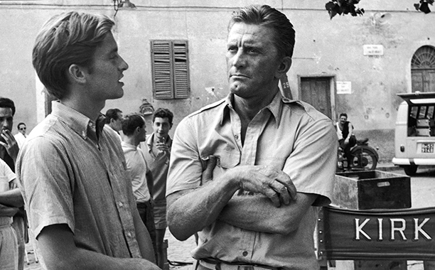 GALLERY: Kirk Douglas Through the Years: GettyImages-1858086.jpg Kirk Douglas (right) and his son American actor Michael Douglas on the set of the film, 'Cast a Giant Shadow,' directed by Melville Shavelson, Rome, Italy, 1965.