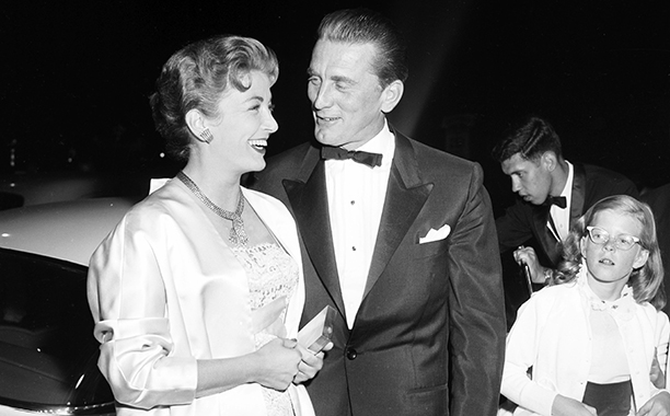 """GALLERY: Kirk Douglas Through the Years: GettyImages-451347941.jpg CIRCA 1956: Actor Kirk Douglas with wife Anne Buydens attend the premiere of """"Lust for Life"""" in Los Angeles, California."""