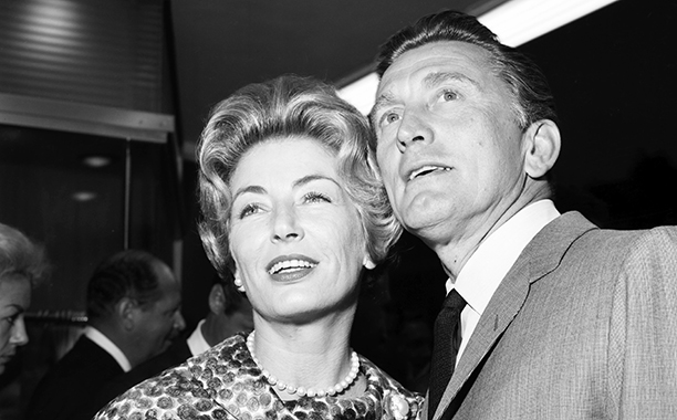 GALLERY: Kirk Douglas Through the Years: GettyImages-451407907.jpg CIRCA 1961: Actor Kirk Douglas and his wife Anne Buydens arrive for a party in Los Angeles, California. (Photo