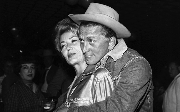 GALLERY: Kirk Douglas Through the Years: GettyImages-499149477.jpg CIRCA 1962: Actor Kirk Douglas and his wife Anne Buydens arrive for a party in Los Angeles, California. (Photo