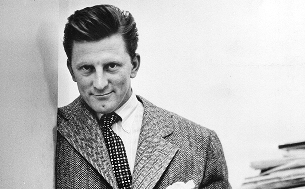 GALLERY: Kirk Douglas Through the Years: GettyImages-625799910.jpg Portrait of American actor Kirk Douglas as he poses with his hands in his pockets, 1950.