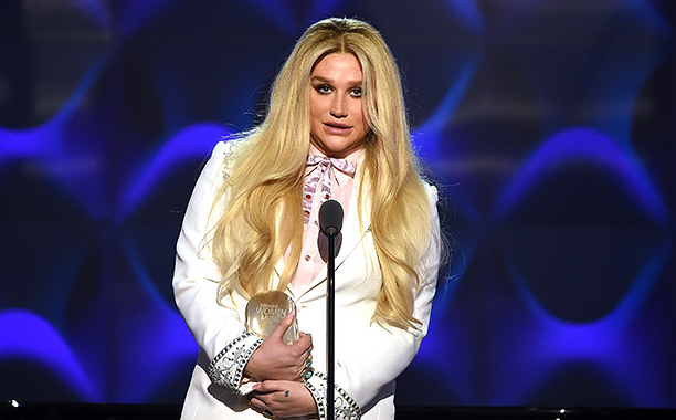 ALL CROPS: 628780256 Kesha presents on stage at the Billboard Women in Music 2016 event on December 9, 2016 in New York City. (Photo by Nicholas Hunt/Getty Images for Billboard Magazine)