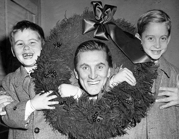 GALLERY: Kirk Douglas Through the Years: GettyImages-97259449.jpg December 15, 1955 Kirk Douglas with sons, Joel and Michael, at Idlewild Airport