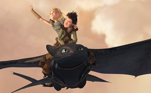 ALL CROPS: How To Train Your Dragon (2010) Astrid (AMERICA FERRERA) and Hiccup (JAY BARUCHEL) soar through the sky on the wings of Toothless