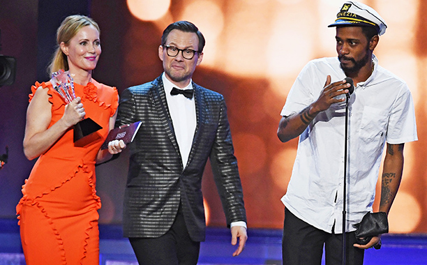 ALL CROPS: 629224170 Keith Stanfield (R) crashes the stage with actors Leslie Mann (L) and Christian Slater (C) during the 22nd Annual Critics' Choice Awards at Barker Hangar on December 11, 2016 in Santa Monica, California. (Photo by Ethan Miller/Getty I