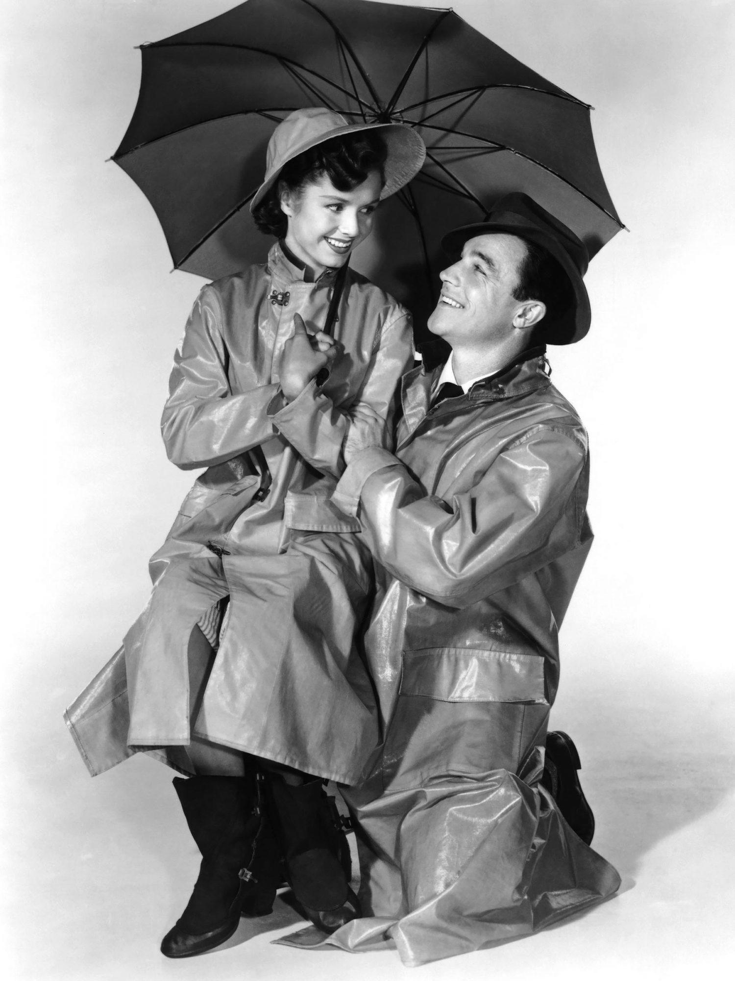 SINGIN' IN THE RAIN, from left, Debbie Reynolds, Gene Kelly, 1952