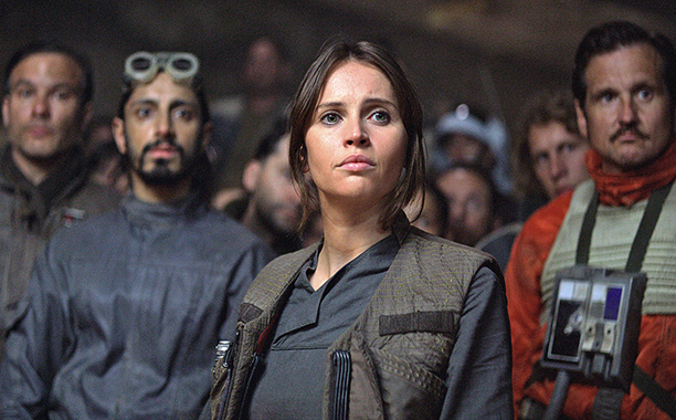 ALL CROPS: Rogue One: A Star Wars Story (2016) Jyn Erso (Felicity Jones) in foreground, Bodhi Rook (Riz Ahmed) in background Copyright 2016 Industrial Light & Magic, a division of Lucasfilm Entertainment Company Ltd., All Rights Reserved