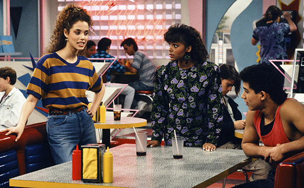 ALL CROPS: 141349136 SAVED BY THE BELL -- 'From Nurse to Worse' Episode 16 -- Air Date 12/15/1990 -- Pictured: (l-r) Elizabeth Berkley as Jessie Spano, Lark Voorhies as Lisa Turtle, Mario Lopez as A.C. Slater-- Photo by: Gary Null/NBCU Photo Bank