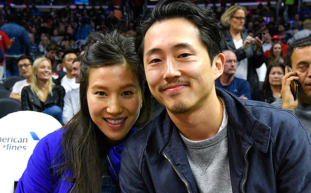ALL CROPS: 621748562 Steven Yeun (R) and Joana Pak attend a basketball game between the Detroit Pistons and the Los Angeles Clippers at Staples Center on November 7, 2016 in Los Angeles, California. (Photo by Noel Vasquez/GC Images)