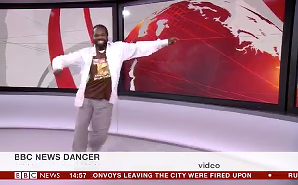ALL CROPS: street dancer danced to the end credits of the BBC news bulletin on the air