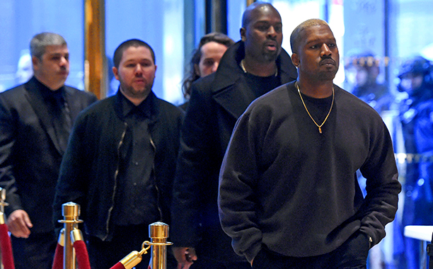 ALL CROPS: 629486870 Kanye West(R) arrives at Trump Tower December 13, 2016 as US President-elect Donald Trump continues to hold meetings In New York. / AFP / TIMOTHY A. CLARY (Photo credit should read TIMOTHY A. CLARY/AFP/Getty Images