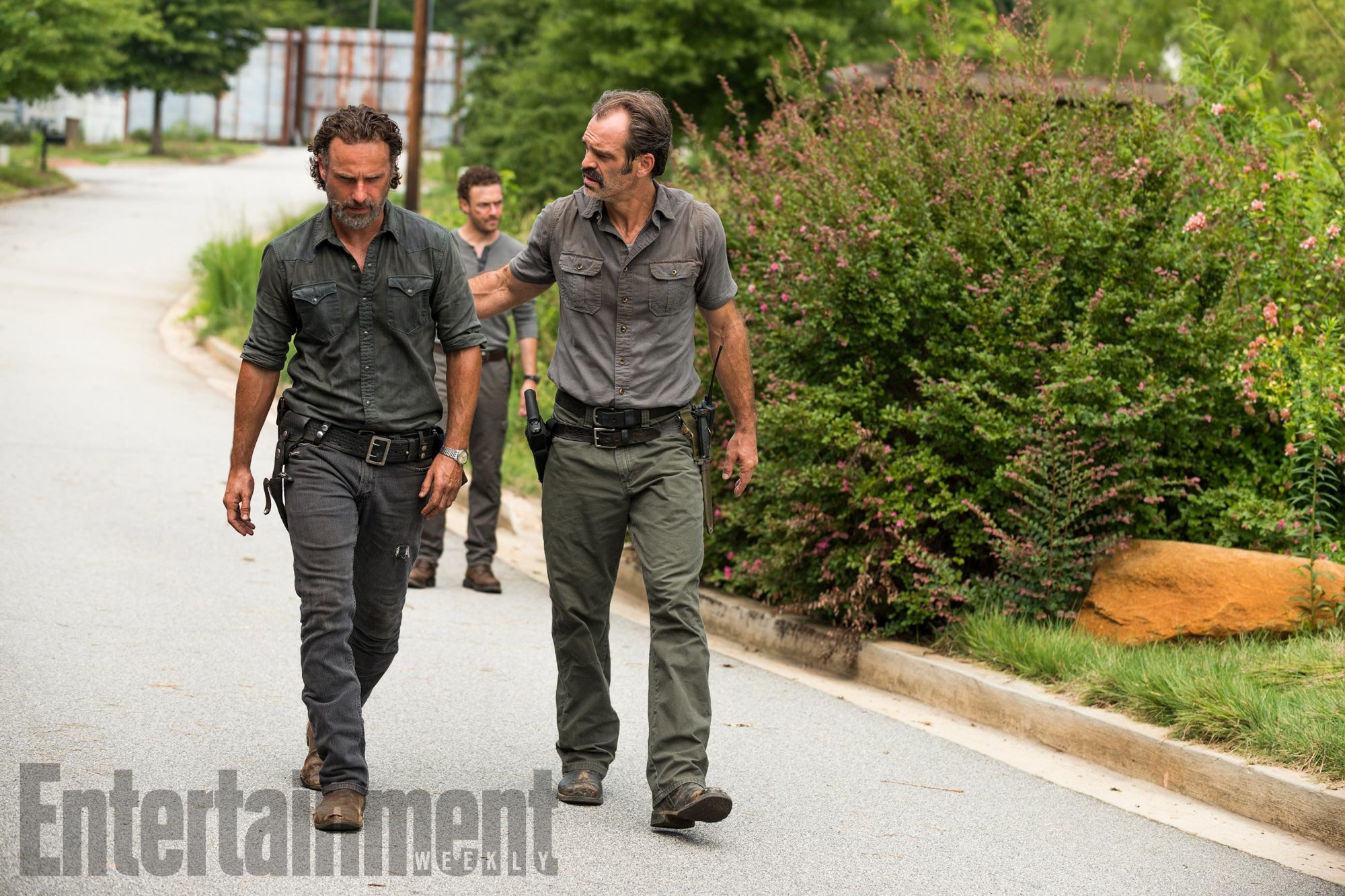 Andrew Lincoln as Rick Grimes, Steven Ogg as Simon