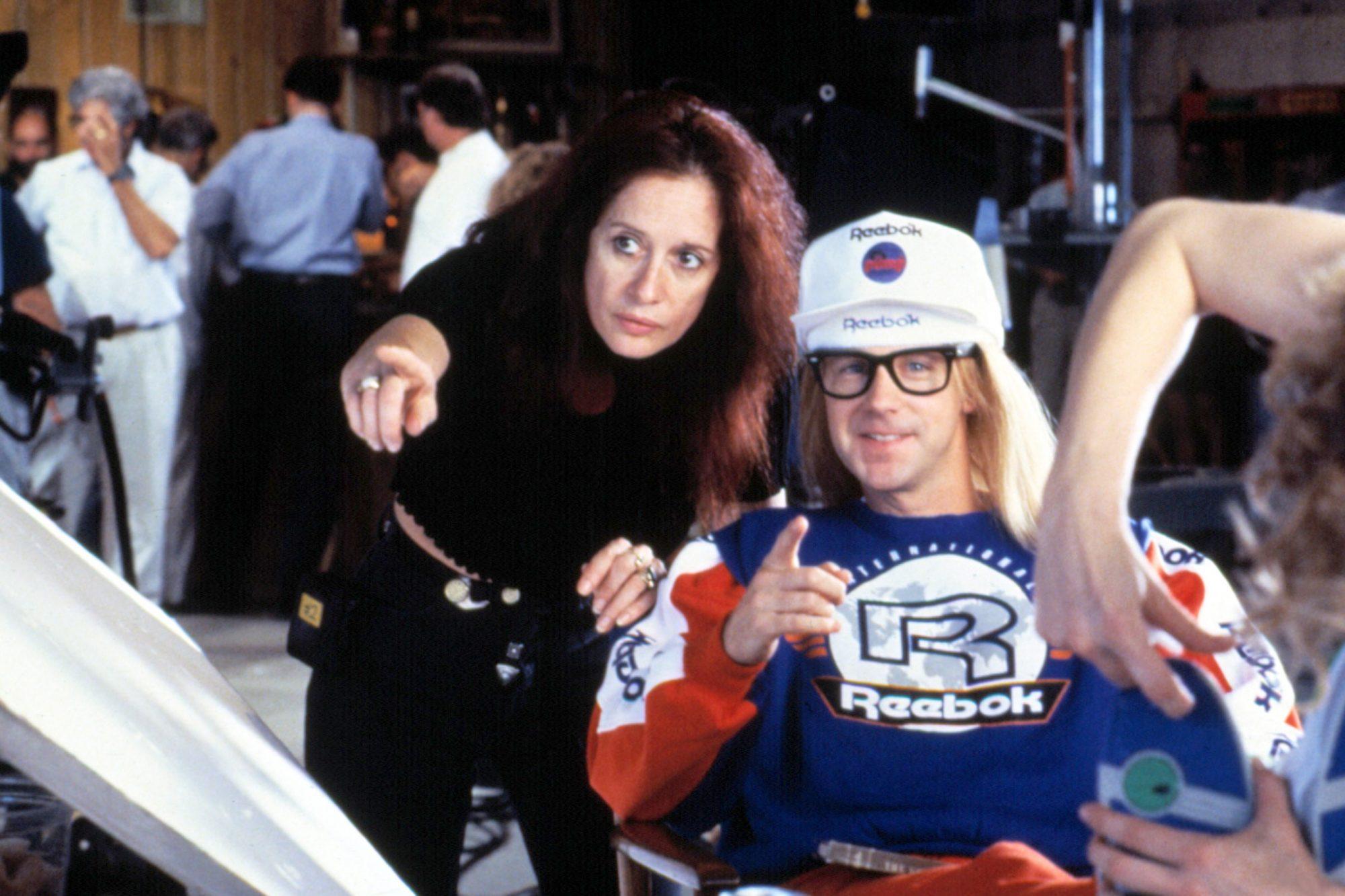Penelope Spheeris directing Dana Carvey on the set of WAYNE'S WORLD, 1992
