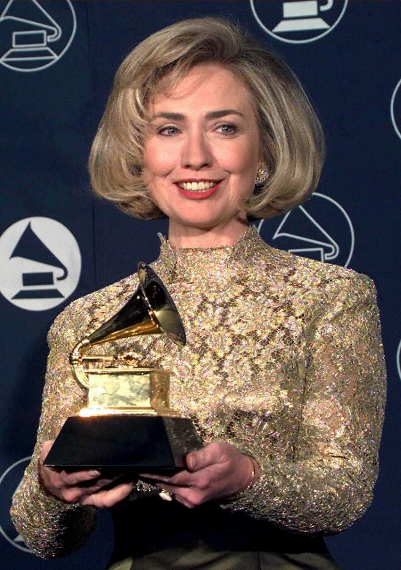 Hillary Rodham Clinton holds up her Grammy Award 2
