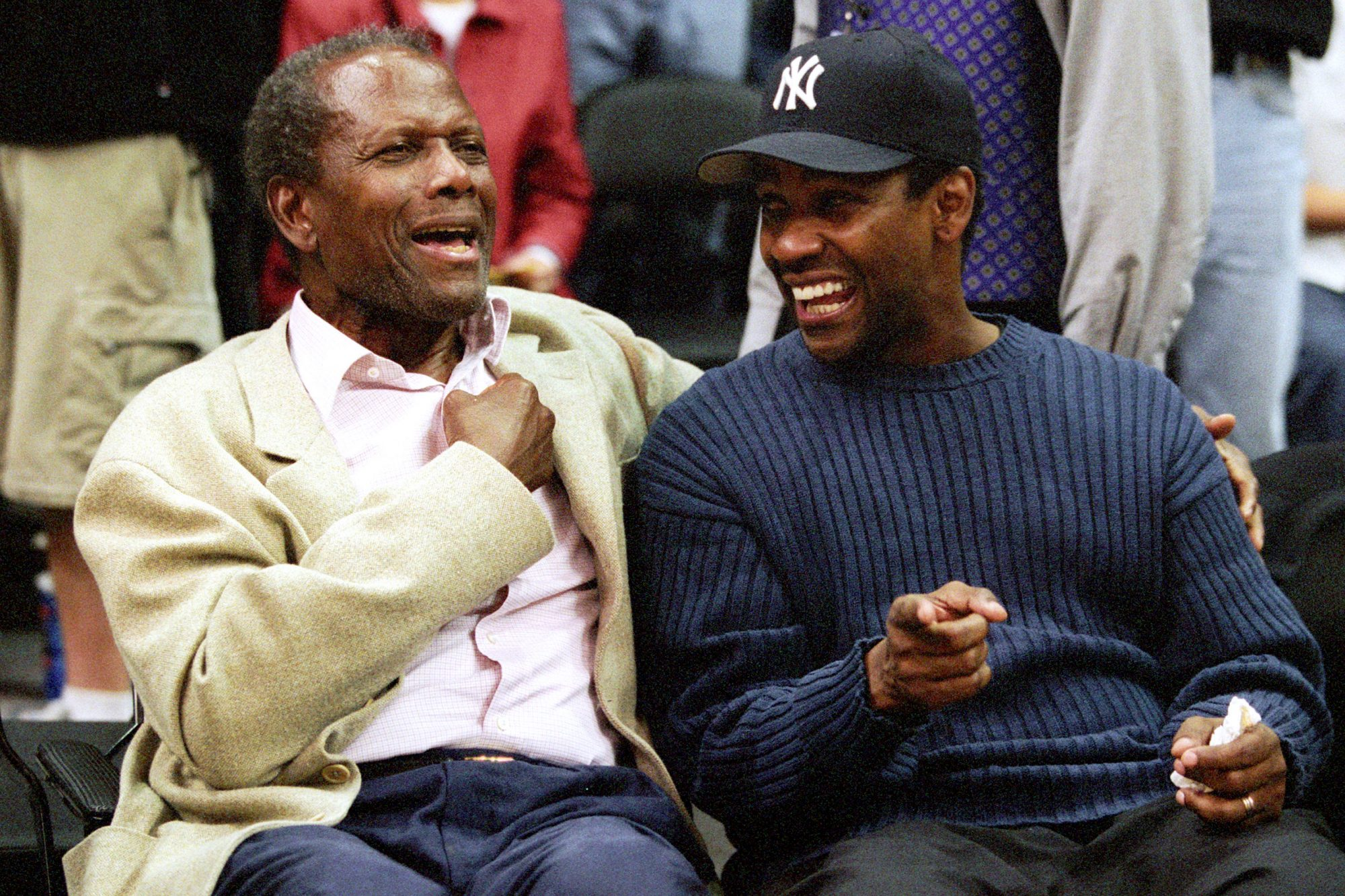 Sidney and Denzel at Game Two of the NBA Playoff with the Los Angeles Lakers