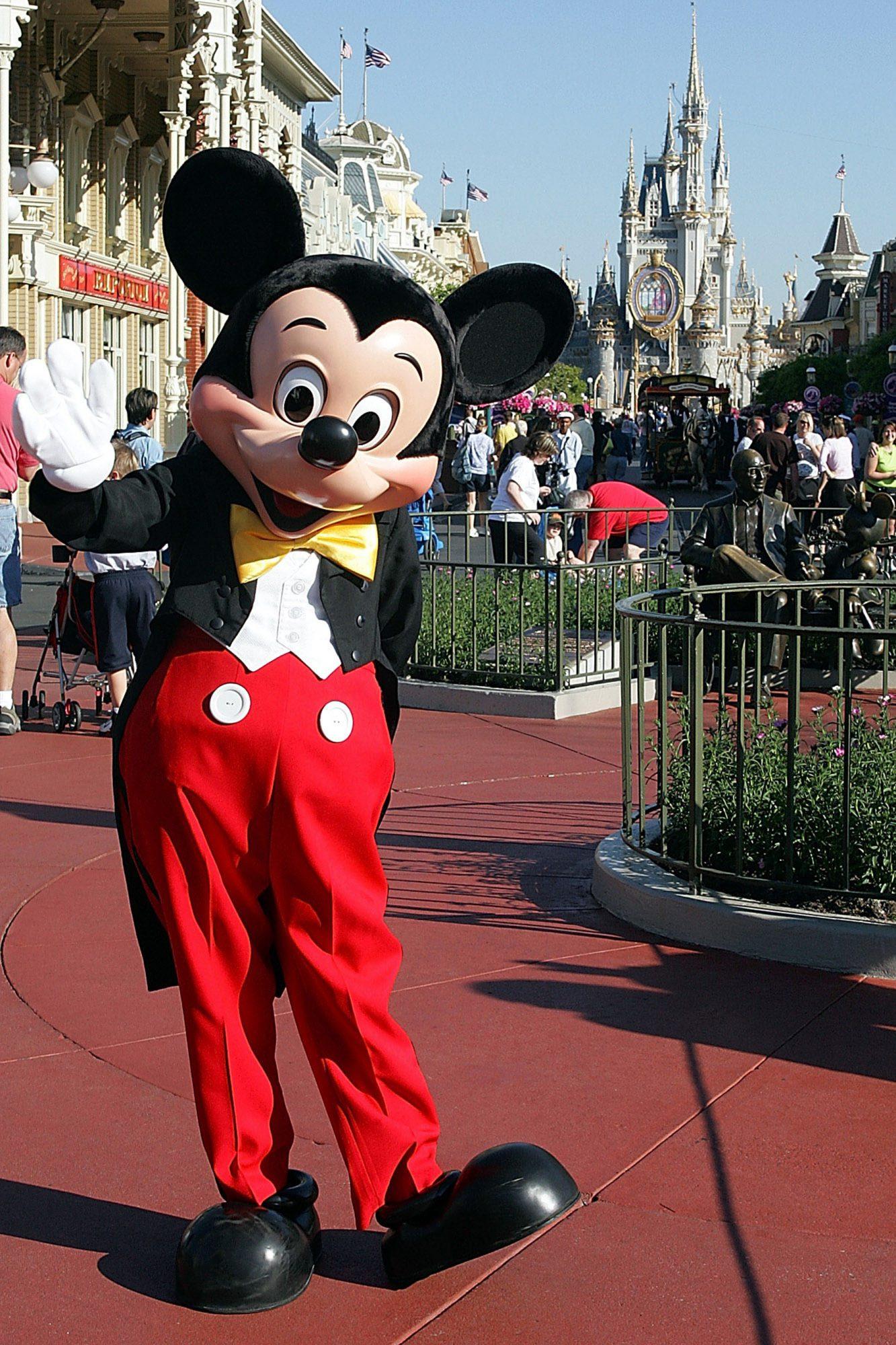 Mickey Mouse greets patrons entering Disney's Magic Kingdom